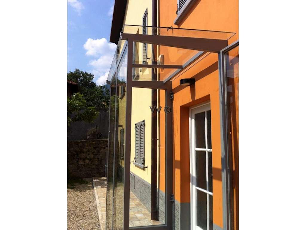 Bussola tettoie serramenti e complementi vetreria valsecchi mario - Tettoia per porta ingresso ...
